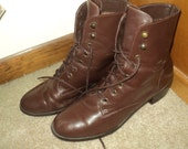 Vintage Size 9 Woman's Boots Made in Brazil with brown leather uppers, stacked wooden heels and man made sole bottoms