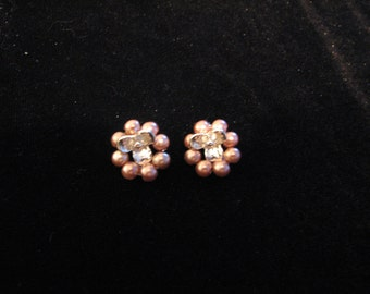 Silver flower surrounded by pink pearls earrings