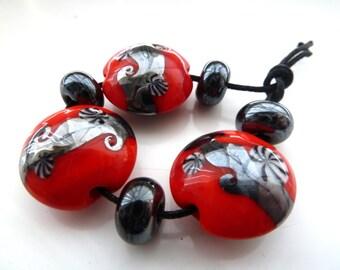 red and silver swirls, handmade lampwork glass beads