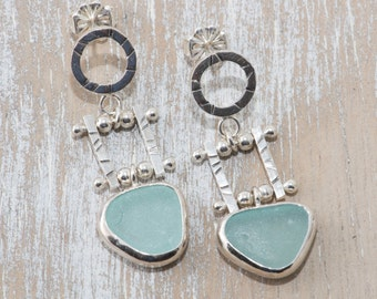 Artisan soft aqua sea glass earrings in sterling silver accented with silver beads.