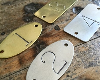 Hand punched brass or aluminum numbered tags -  Custom numbered locker tags - rectangle or oval number plates - hotel room numbers