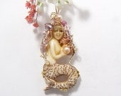 Mermaid carved in India from bone.  Wire wrapped Mermaid in 14k gold fill wire (w121611)