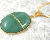 Kintsugi (kintsukuroi) green aventurine oval stone cabochon pendant with gold repair in gold setting with snake chain - OOAK