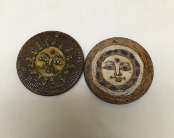 pair of woodburned and painted pendants Sun and Moon