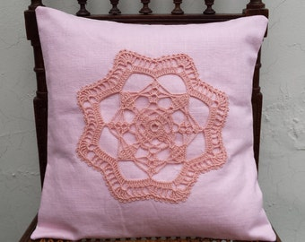 Pink linen cushion cover with a pink flower doily