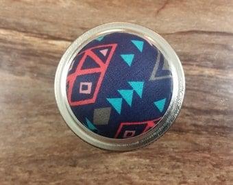 Geometric shapes on a pin cushion jar