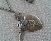 Large Pressed Heart with Floral and Scroll Design Pendant with Small Heart and Small Skeleton Key Charms Necklace and Link Chain Jewelry