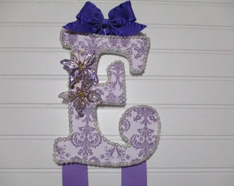 """BOW HOLDER lavender and purple, Initial """"E"""", butterflys, pearl trim, little bows on ends"""