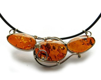 Natural Baltic cognac amber pendant.