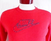 vintage 90's Nike graphic sweatshirt red fleece embroidered black swoosh block letter spellout logo crew neck unisex pullover jumper small