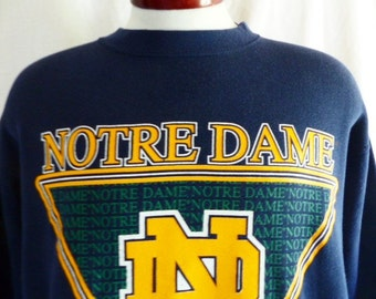 Go UND Fightin' Irish vintage 80's 90's University of Notre Dame navy blue fleece graphic sweatshirt gold yellow green logo crew neck