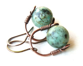 Turquoise blue earrings - Copper wire wrapped stirrup & teal stone bead