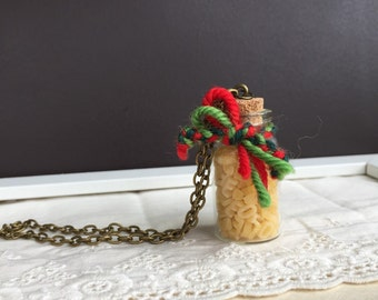 A jar of L. O. V. E.  Alphabet pasta pendent. Letter shaped pasta in tiny jar.