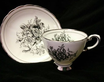 Black Flowers by Tuscan Tea Cup and Saucer