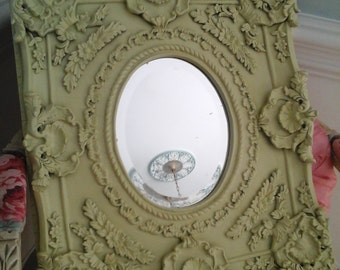 Ornate olive beveled mirror