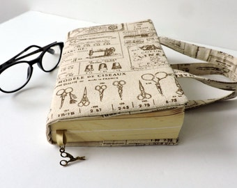 Book cover with handles and scissor charm. Vintage sewing print linen Book bag. Paperback book jacket. Book sleeve. Bible cover.