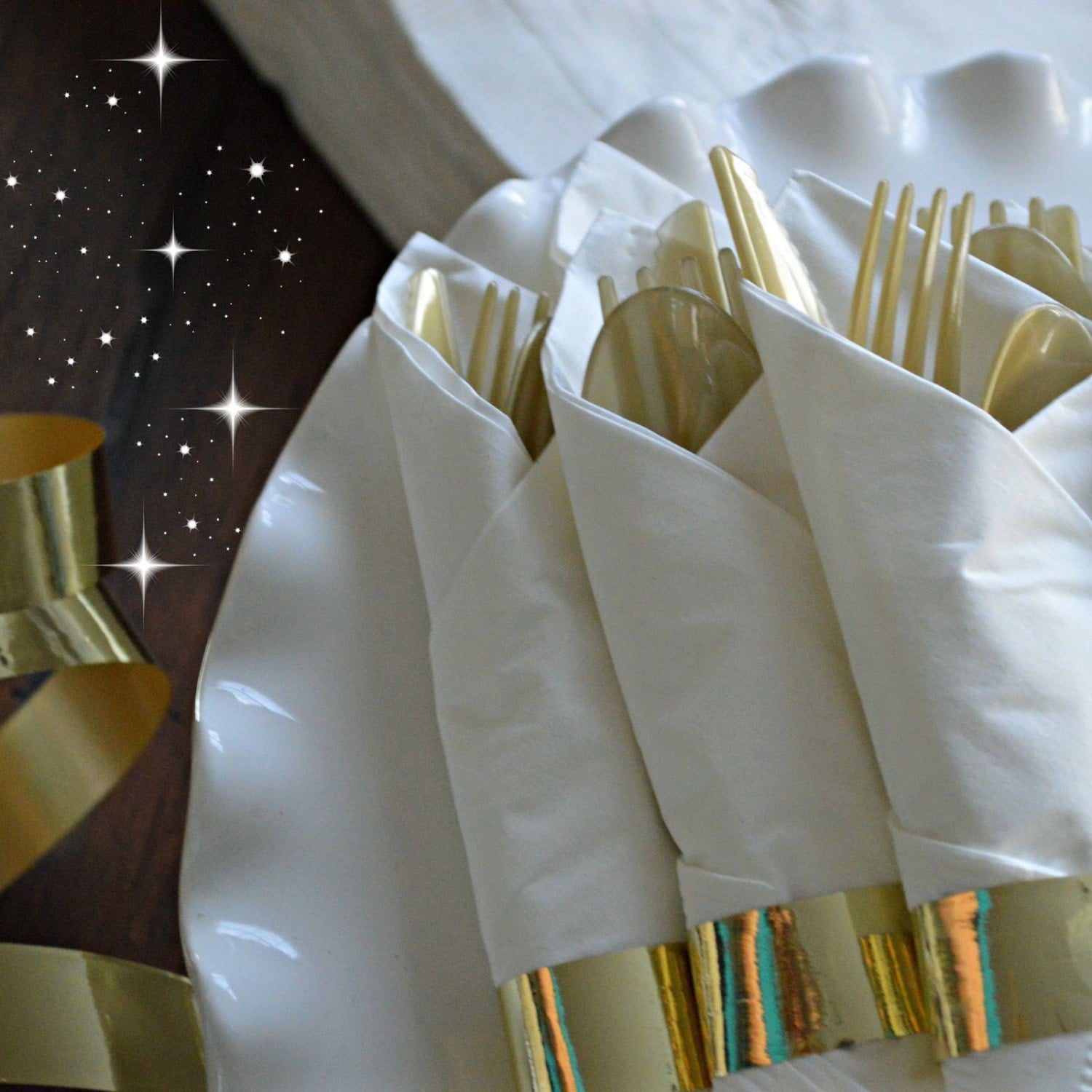 gold party decorations  gold flatware  knives folks spoons  great gastby theme  alice in