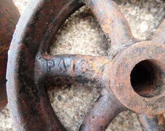 Vintage industrial machine age warehouse cart cast iron wheels (a pair).