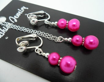 A hand made pink  glass pearl  necklace and  clip on earring set.