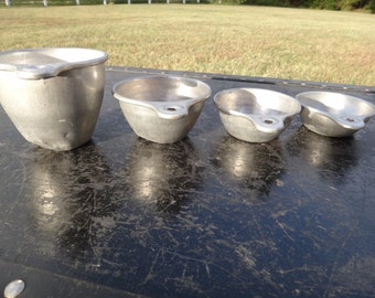 Set of 4 vintage metal measuring cups with tabs