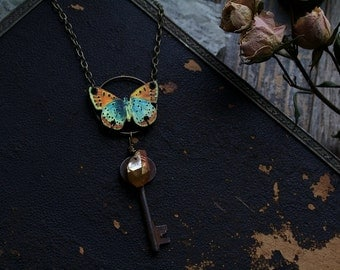 Antique orange/blue butterfly with 1800s Victorian cast iron skeleton key, wire wrapped peach titanium crystal quartz necklace