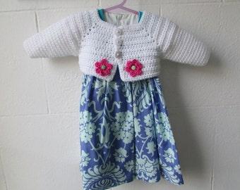 Crochet girls shrug cardigan with pink flower detail