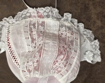 Rows of Heirloom French lace insertion of a baby bonnet or hat, Christening, Dedication with Swiss batiste fabric