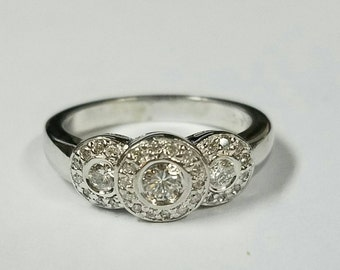 14kt white gold Past Present and Future halo diamond ring