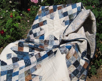 Blue, Brown, and Cream Winter Star Batik and Floral Lap-Size Quilt