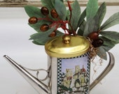 Decorative metal oil can with olive branch arrangement