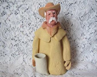 Vintage  Cowboy Pottery Sculpture signed by sculptor