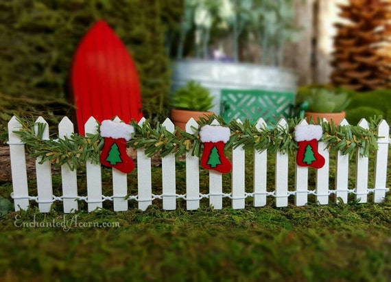 Miniature White Picket Fence With Garland And Christmas