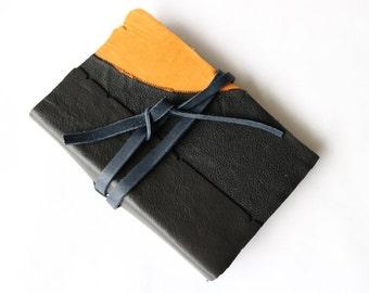 Black and Orange Sketch Book with Blue Tie