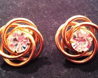 Earrings - Gold swirls with a rhinestone center, screw-back