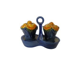 A pair of vintage Made in Japan ceramic iris salt & pepper shakers with caddy