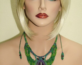 Macrame necklace using fluorite gemstone pendant with adjustable sliding knot closure.