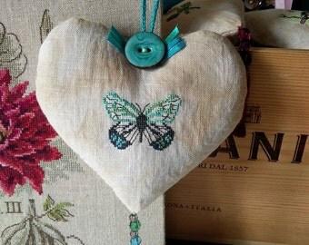 Heart shape handmade home décor with a butterfly