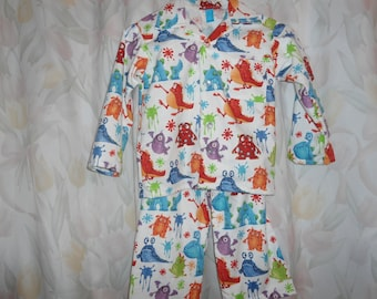Size 3 Boys Pajamas with monsters & blobs on white background