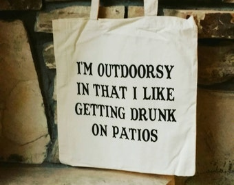 "I'm outdoorsy in that i like getting drunk on patios 16"" Large Cotton Canvas Tote Bag"
