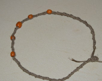 Hemp necklace with orange wooden beads