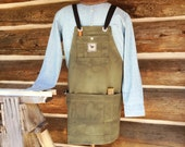 Waxed filter twill canvas woodshop apron with adjustable crossed straps. Heavy, durable apron for a woodworker. Free shipping to US.