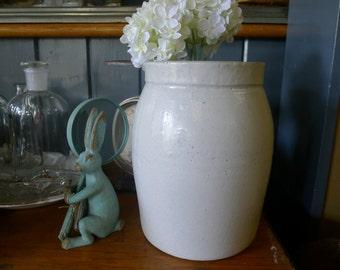 Glazed gallon cream-colored crock