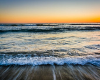 Sunset over waves in the Pacific Ocean, in Santa Monica, California. | Photo Print, Stretched Canvas, or Metal Print.