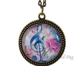 Treble Clef Music Glass Pendant Necklace In Bronze Setting