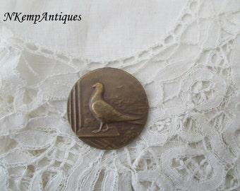 Vintage bird medal