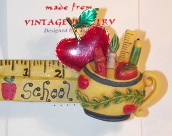 Teacher / School theme,  1-of-a-kind Collage Brooch and/or Pendant made w/ vintage jewelry. Red, Apple, pencil holder, ruler, pens. #11h.