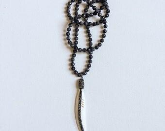 larvikite gemstone necklace + bone feather pendant ||  swarovski crystal detailing on pendant ||
