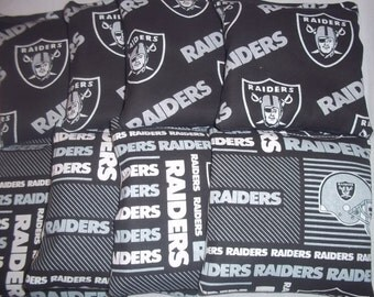 8 ACA Regulation Cornhole Bags - 8 handmade from Oakland Raiders Fabric on 2 Different Prints