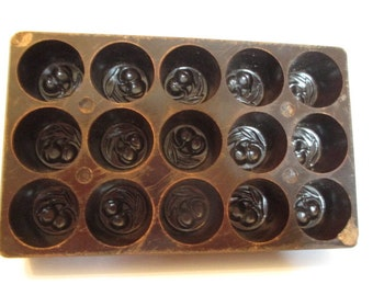 Wonderful 1930s bakelite chocolate mould - cherry kirsch