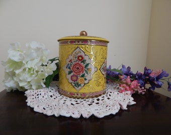 Yellow floral tin canister